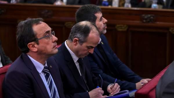 Josep Rull, Jordi Turuill y Jordi Sánchez, durante el juicio del 1-O