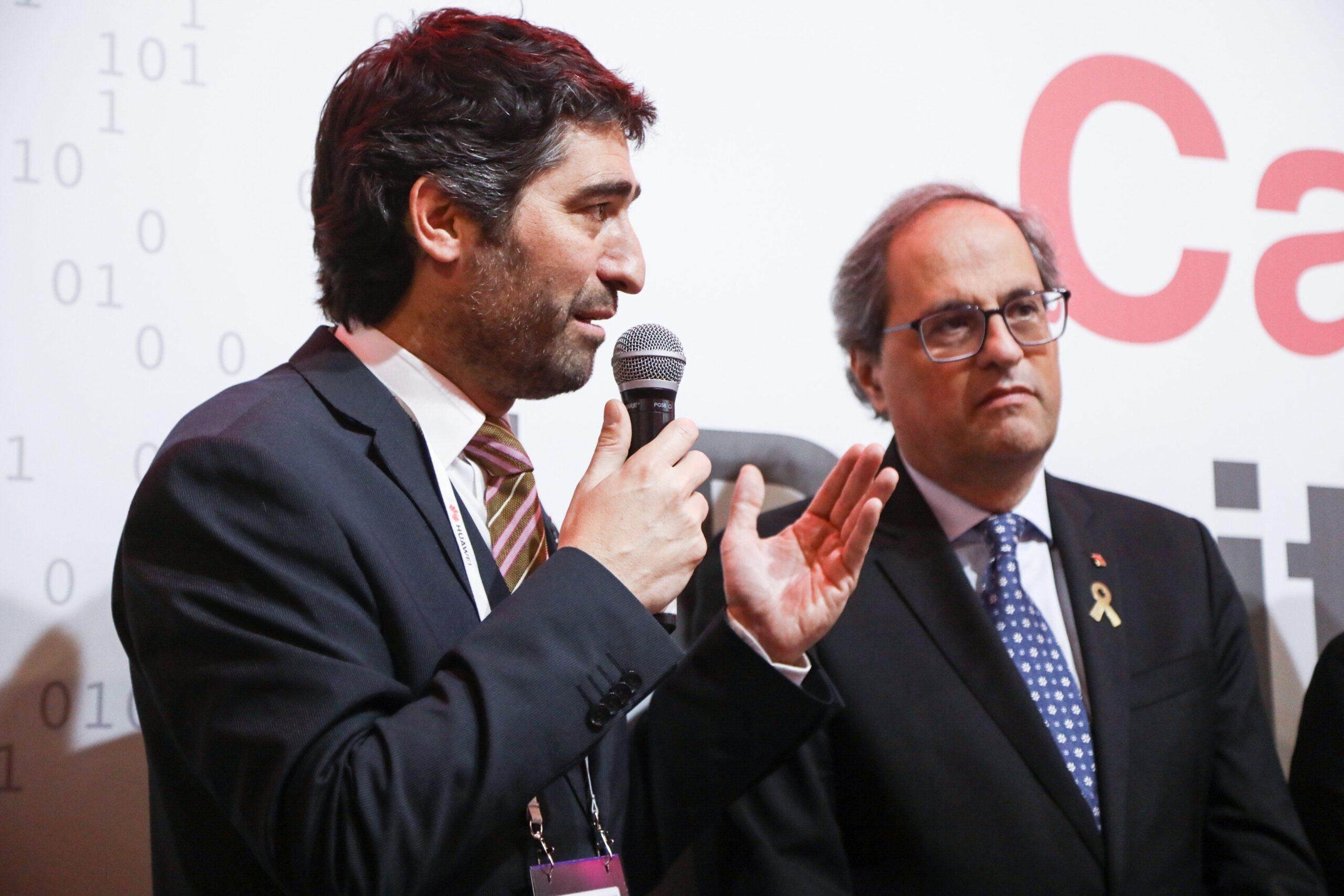 Jordi Puigneró, intervenint en presència del president Qu...
