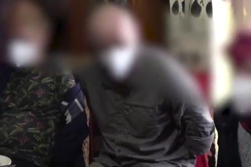 Tres de los detenidos, durante un registro de los Mossos